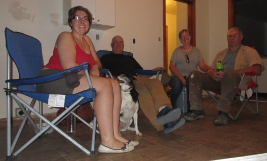 four people sit in chairs